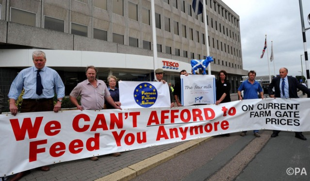 Dairy farmers protest outside Tesco HQ over their milk price contract.