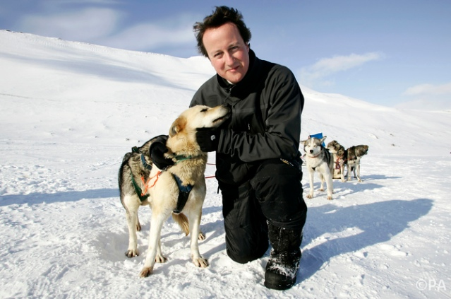 An environmental activist named David Cameron hugs a husky in Svalbard, 2006.